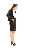 Angry businesswoman looking down Royalty Free Stock Photography