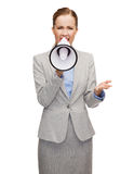 Angry businesswoman with megaphone Royalty Free Stock Image
