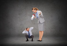Angry businesswoman with megaphone Stock Photography
