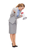 Angry businesswoman with megaphone Stock Photos