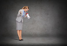 Angry businesswoman with megaphone Stock Photo