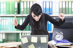 Angry businesswoman at the office Stock Images