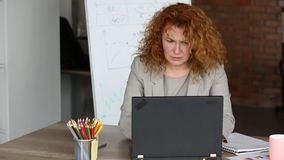 Angry businesswoman in the office holding board with word HELP. stock video