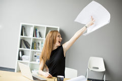 Angry businesswoman in the office. View at Angry businesswoman in the office Royalty Free Stock Photography