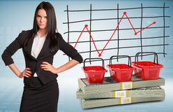 Angry businesswoman with packs dollars Stock Image