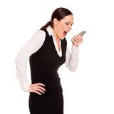 Angry businesswoman with phone royalty free stock photo