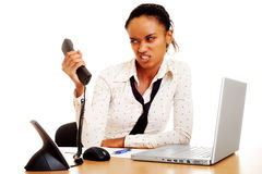 Angry businesswoman with phone Stock Photos
