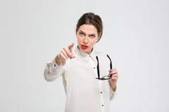Angry businesswoman pointing finger at camera Stock Image
