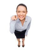 Angry businesswoman pointing finger at you Stock Photo