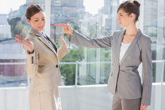 Angry businesswoman pointing at her rival Stock Image