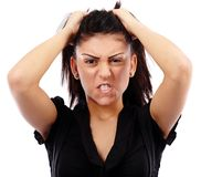 Angry businesswoman pulling her hair Royalty Free Stock Photo
