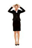 Angry businesswoman pulling her hair and screaming Royalty Free Stock Photos