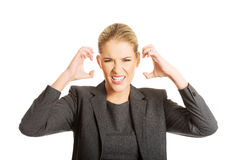Angry businesswoman pulling her head Stock Images
