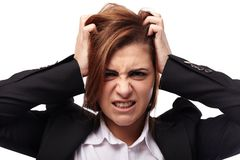 Angry businesswoman pulling off her hair Royalty Free Stock Images