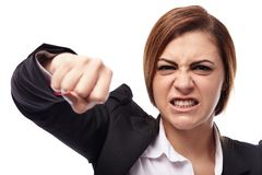 Angry businesswoman punching Stock Photography