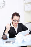 Angry businesswoman reading files. Royalty Free Stock Image