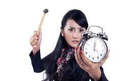 Angry businesswoman ready to hit an alarm clock Stock Photos
