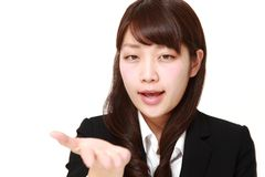 Angry businesswoman requests something Stock Images