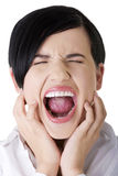 Angry businesswoman screaming. Stressed or angry businesswoman screaming loud Royalty Free Stock Photo