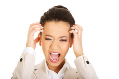Angry businesswoman screaming. Royalty Free Stock Image