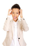 Angry businesswoman screaming. Stock Image