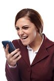 Angry businesswoman screaming into the cell phone. Portrait of angry businesswoman holding a cell phone and screaming into it, isolated on white background Stock Images