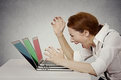 Angry businesswoman screaming at computer. Furious, angry businesswoman screaming at computer, off has nervous breakdown can't take it anymore isolated grey wall royalty free stock images