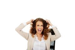 Angry businesswoman screaming. Stock Photo