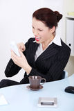 Angry businesswoman screaming to phone. Pretty caucasian businesswoman screaming to phone in the office Royalty Free Stock Photography