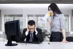 Angry businesswoman screams at her worker Stock Image