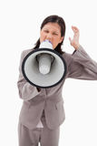 Angry businesswoman shouting through businesswoman Royalty Free Stock Photos