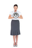 Angry businesswoman shouting in her megaphone Stock Photography