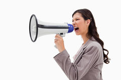 Angry businesswoman shouting through megaphone Stock Image
