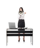 Angry businesswoman shouting with a megaphone Royalty Free Stock Images
