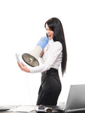 Angry businesswoman shouting with a megaphone Royalty Free Stock Photos