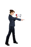 Angry businesswoman shouting through megaphone and pointing Royalty Free Stock Photography