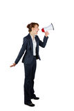 Angry businesswoman shouting through megaphone Royalty Free Stock Photography