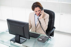 Angry businesswoman shouting into phone Stock Images