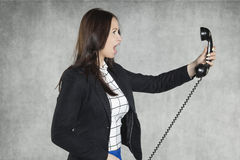 Angry businesswoman shouting on the phone Royalty Free Stock Photos