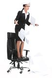 Angry businesswoman shouting when standing on chair. royalty free stock photo
