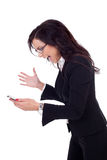 Angry businesswoman shouting to a mobile Stock Images