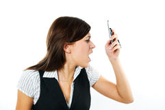 Angry businesswoman shouting to mobile Stock Image