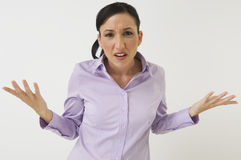 An Angry Businesswoman Shrugging Stock Photos