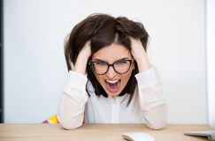 Angry businesswoman sitting at the table Royalty Free Stock Photo