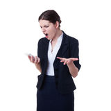 Angry businesswoman standing over white isolated background Royalty Free Stock Image