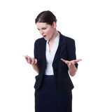 Angry businesswoman standing over white isolated background Stock Image