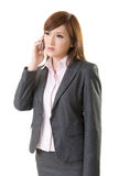 Angry businesswoman talk on phone Stock Photography