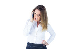 Angry businesswoman talking on the phone Stock Images