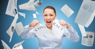 Angry businesswoman tearing contract Royalty Free Stock Image