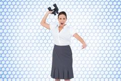 Angry businesswoman throwing binoculars away Stock Photos